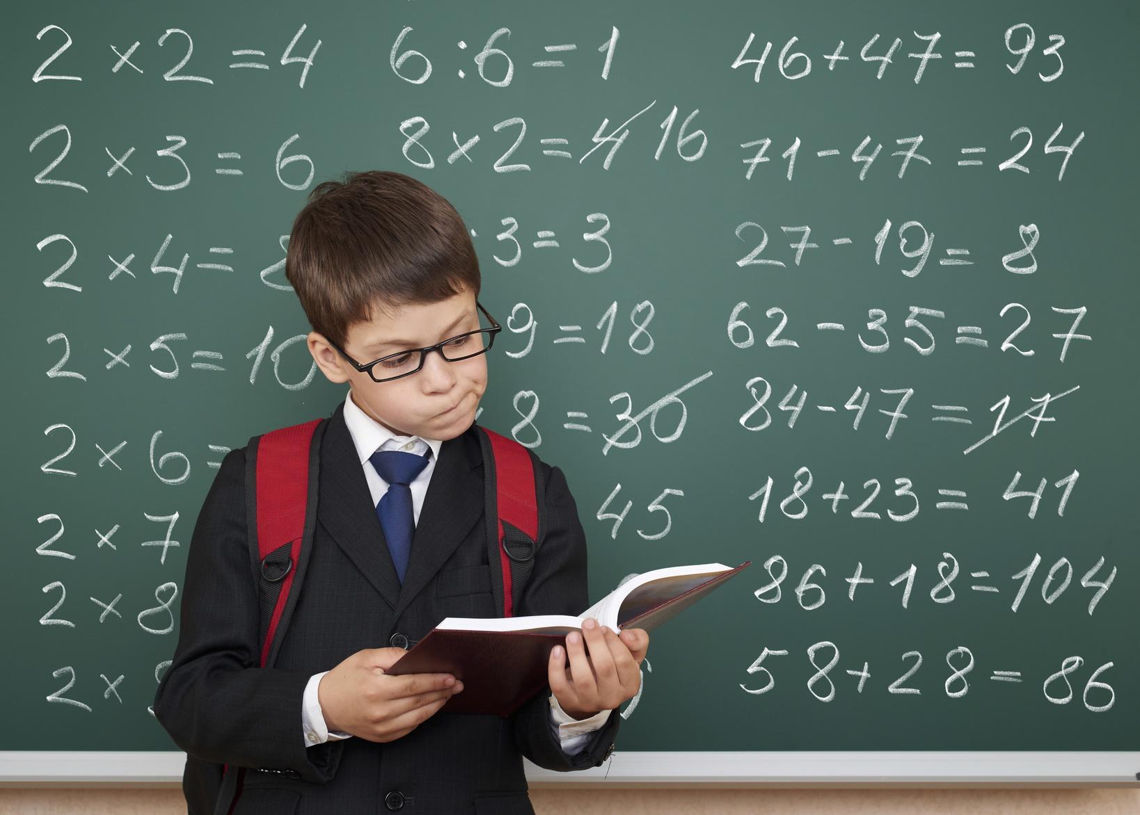 boy exercise math on school board